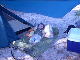 Jack and Tigar camping on his swag